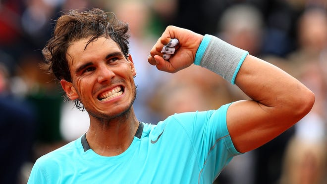 Rafael Nadal of Spain celebrates victory in his men's singles match against Dominic Thiem of Austria on Day 5 of the French Open at Roland Garros.