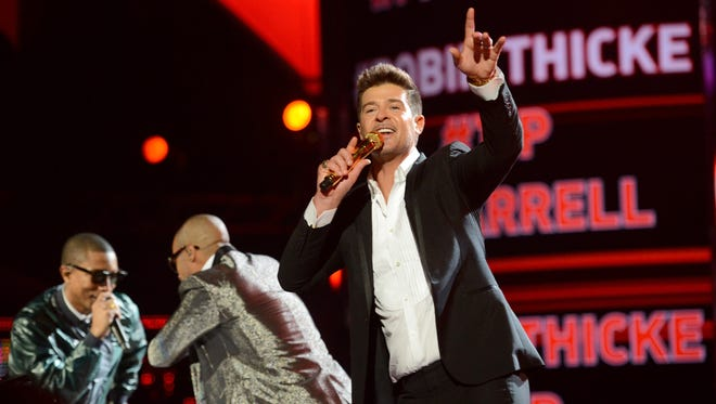 Pharrell Williams (from left), T.I. and Robin Thicke perform at the 2013 BET Awards at Nokia Theatre on June 30, 2013, in Los Angeles.