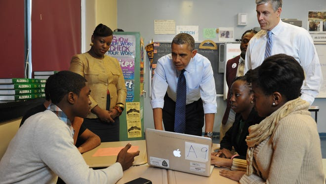 President Obama listens to a student Oct. 25, 2013, during a visit to a classroom at Pathways in Technology Early College High School in Brooklyn, N.Y.