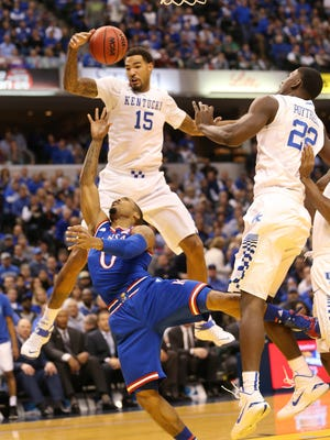 Kentucky Wildcats forward Willie Cauley-Stein and forward Alex Poythress were too tall for Kansas guard Frank Mason III to get a shot off in the first half.