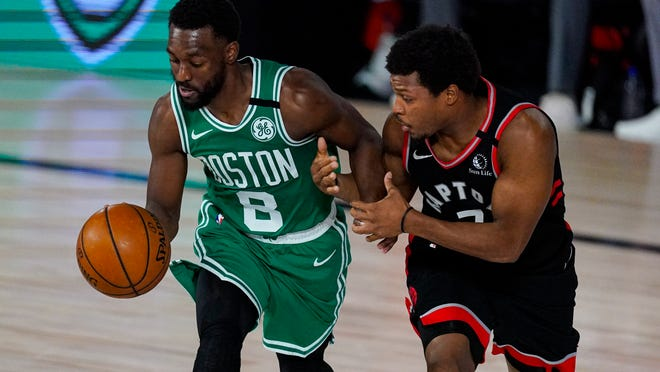 Toronto Raptors guard Kyle Lowry (7) tries to hold on to Boston Celtics guard Kemba Walker (8) during the second half of an NBA conference semifinal playoff basketball game Wednesday, Sept. 9, 2020, in Lake Buena Vista, Fla.