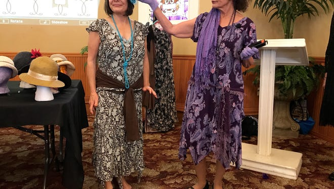 Docent Connie Korenstein, right, talks about a flapper-style outfit worn by Dale Gordon, of Camarillo. People planning to attend the upcoming spring tea at Heritage Square in Oxnard got some lessons on how to put together a 1920s-style outfit.
