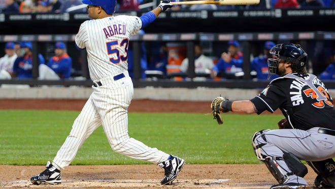 Mets right fielder Bobby Abreu hits a two-run home run in the first inning against the Miami Marlins at Citi Field Saturday night.
