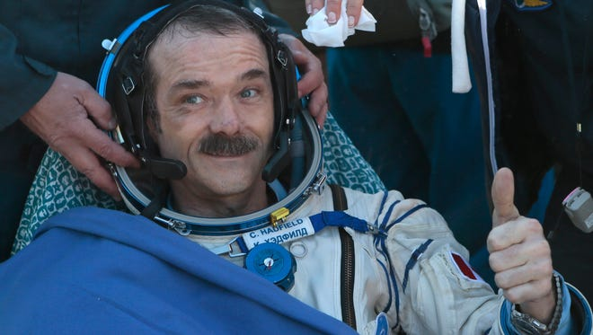 Canadian astronaut Chris Hadfield gives a thumbs up in May 2013 shortly after the landing aboard the Russian Soyuz space capsule in central Kazakhstan.