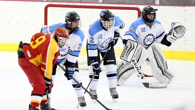 Suffern goalie Sean Gordon (30) sets for a face-off in the zone during a hockey game against Williamsville East in the New York State Great 8 hockey tournament at the Ice Hutch in Mount Vernon on Dec. 12, 2015.