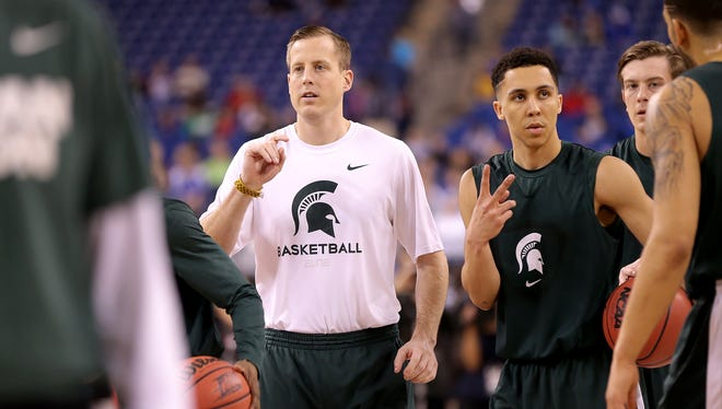 Former Hoosier Dane Fife now an assistant coach for Michigan State helps with MSU's Final Four practice April 3, 2015 at Lucas Oil Stadium.