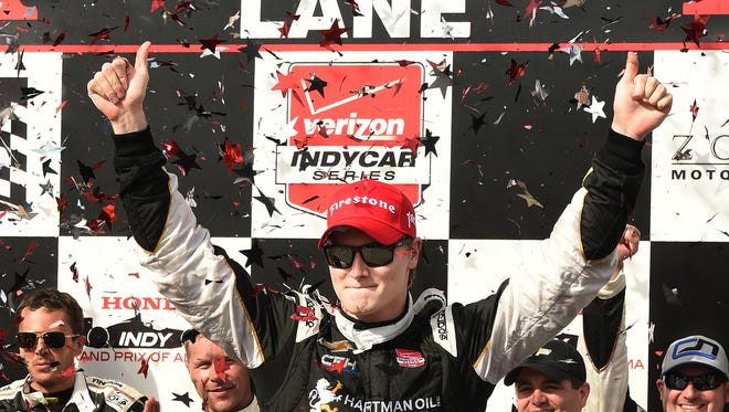 Josef Newgarden (67) celebrates after winning the Indy Grand Prix of Alabama at Barber Motorsports Park, Sunday, April 26, 2015, in Birmingham, Ala. Newgarden held off a hard-charging Graham Rahal on Sunday in the Indy Grand Prix of Alabama for his first IndyCar Series victory.
