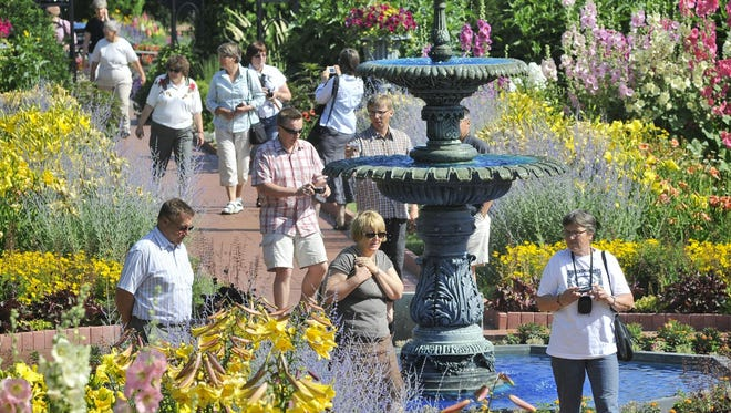 People tour Clemens Gardens, the site of this Tuesday's Walk in the Park.
