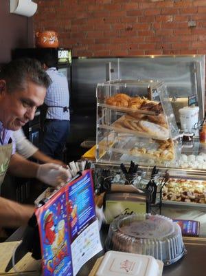 Juan Carlos Ramirez Sr. at the front counter of Xielo Artisan Desserts located in Oxnard.
