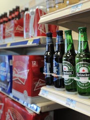 Warm beer sits on the shelves of the Rickers at 116th Street and Cumberland Road in Fishers on May 14, 2013.