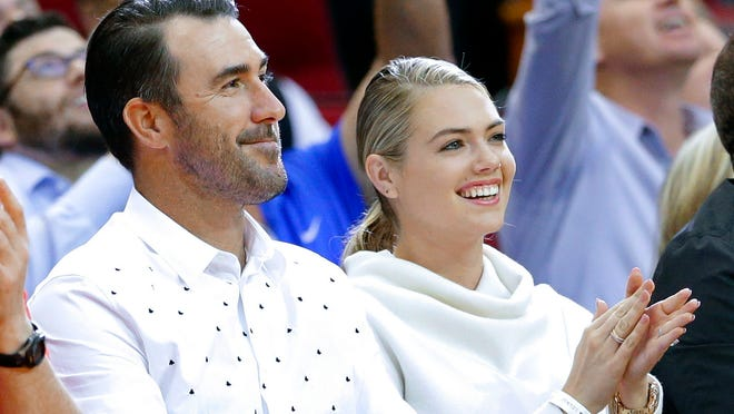 Houston Astros pitcher Justin Verlander and his wife, model Kate Upton attend an NBA basketball game between the Portland Trail Blazers and the Houston Rockets Thursday, April 5, 2018, in Houston. (AP Photo/Michael Wyke)