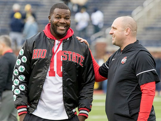 Former Ohio State quarterback Cardale Jones, left, and OSU assistant coach Zach Smith talk before the game between the University of Michigan and Ohio State at Michigan Stadium in Ann Arbor on Nov. 25, 2017.