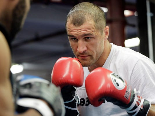 Boxer Sergey Kovalev spars with a partner during a workout at Gleason's Gym, Tuesday, Nov. 4, 2014 in the Brooklyn borough of New York. Kovalev fights Bernard Hopkins in a light heavyweight bout, Saturday, Nov. 8 in Atlantic City, N.J. (AP Photo/Mark Lennihan)