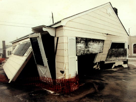 A house is split apart by the raging waves during the