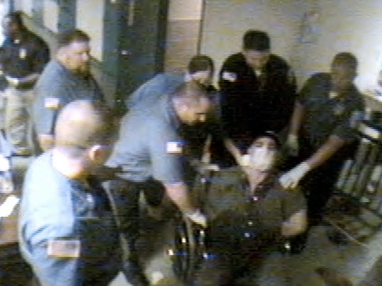 The altercation between Amit Bornstein and officers at the Monmouth County Jail is shown in a surveillance video photo. Bornstein was placed in a wheelchair during the altercation. The alterncation between Amit Bornstein and officers at the Monmouth County Jail is shown in this surveillance video that was released after an order from the US District Court. BORNSTEIN1121C ~