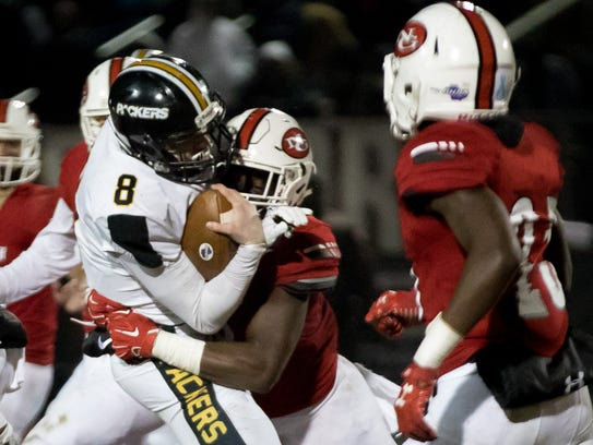 North Gwinnett High School's Jayden Mcdonald (8) tackles