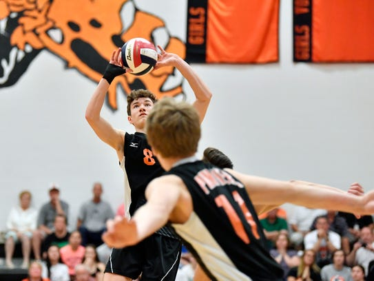 Central York's Brock Anderson sets the ball against