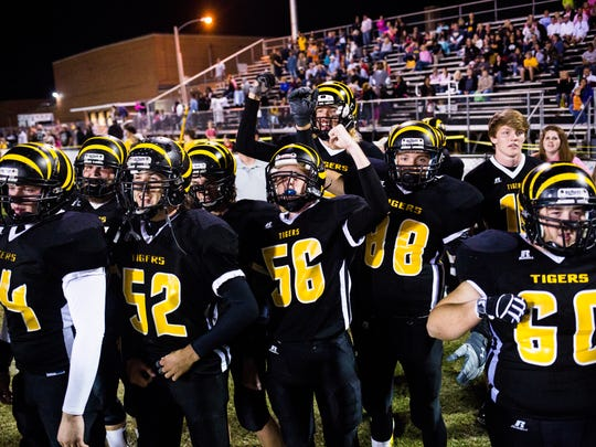 Crescent players celebrate their win over Pendleton as the clock runs out in the fourth quarter on Friday, October 14, 2016 in Iva.