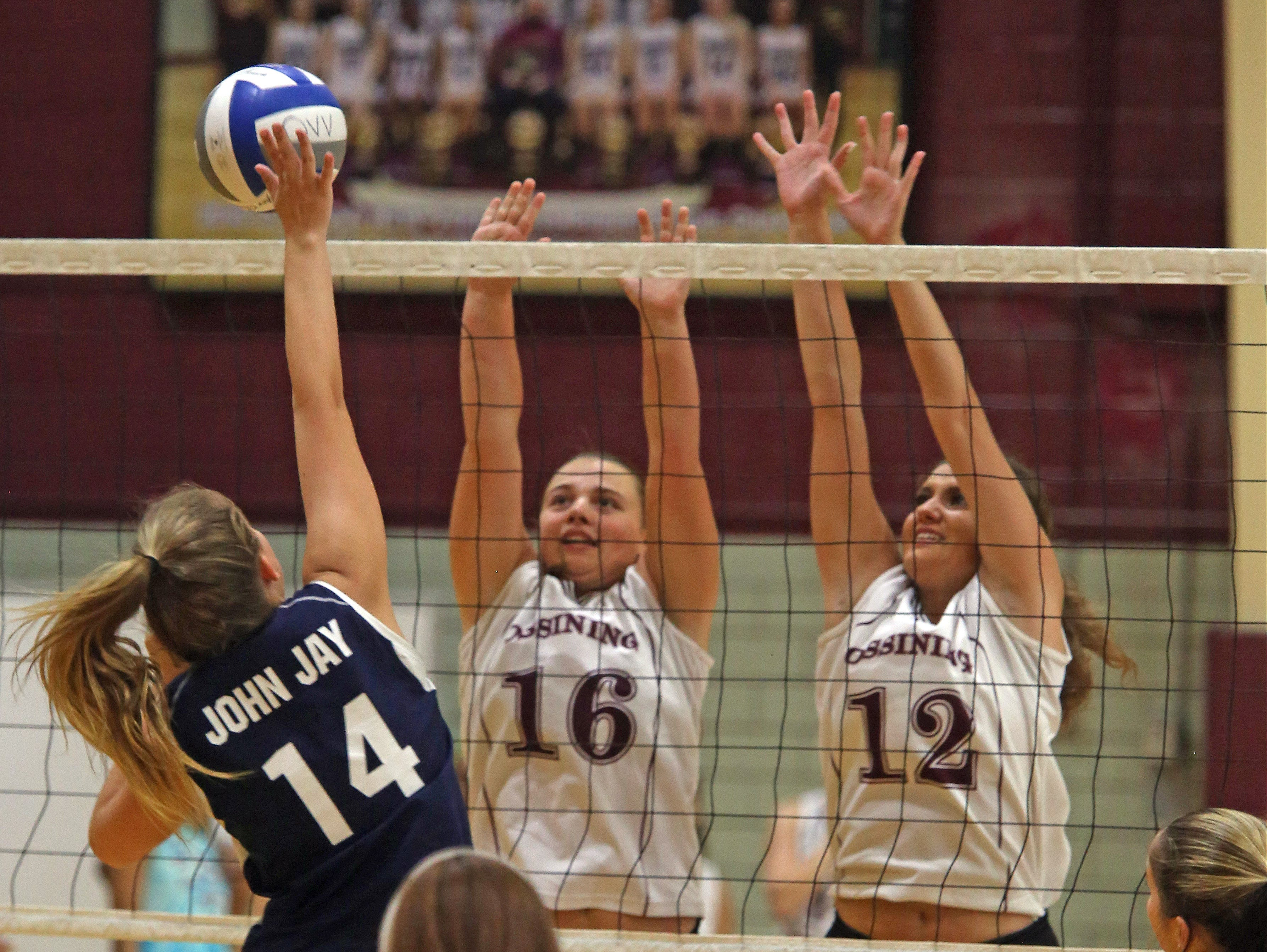 Ossining's Kelsey Quain (16) and Carmela Velardo (12) blocks John Jay East Fishkill shot during girls volleyball at Ossining High School on Tuesday, Sept. 6, 3016.