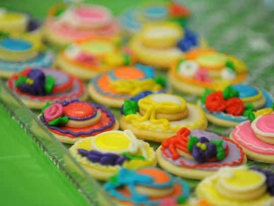 Hat-shaped cookies were available in memory of Roy Helen Ackers, who was known for her colorful hats.
