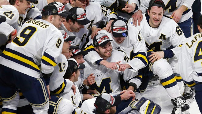 Michigan players pose for a team photo after defeating Boston University, 6-3, in the NCAA northeast regional championship in Worcester, Mass., Sunday.