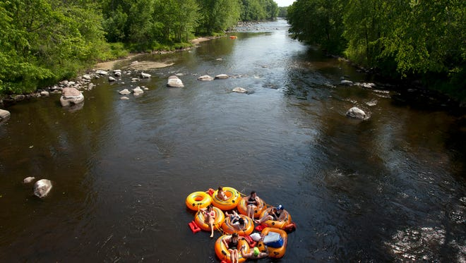 Tubers float along the Wolf River in New London, Wisconsin.