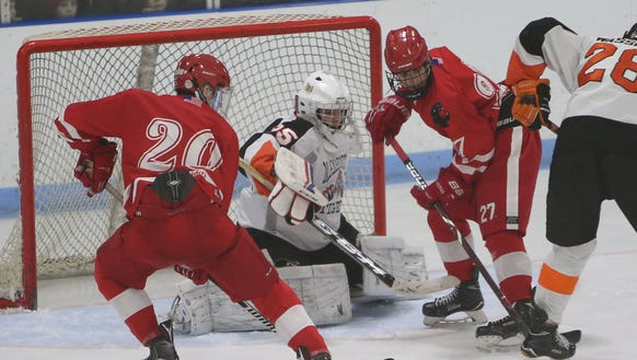 From left, North Rockland's Luke Morris (20) and Collin
