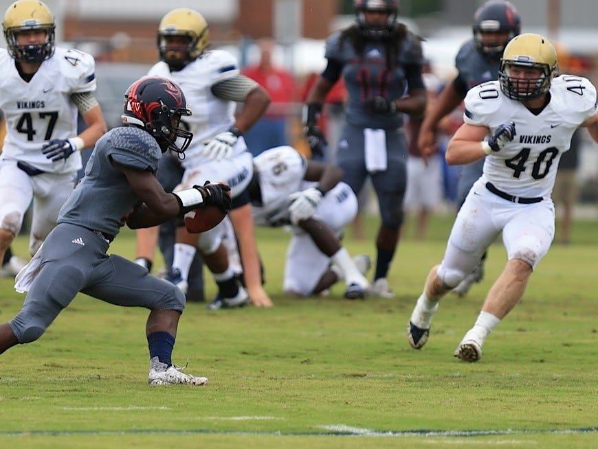 Wakulla's Justin Davis tries to evade Spartanburg tacklers during Saturday's game, which was shown on ESPN U.