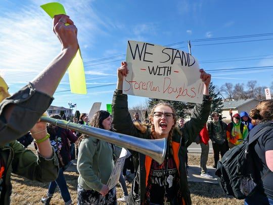 Hempstead High School students exit the school during a gun violence protest in Dubuque, Iowa, Wednesday, March 14, 2018. Students across the country participated in walkouts Wednesday to protest gun violence, one month after the deadly shooting inside a high school in Parkland, Fla. (Nicki Kohl/Telegraph Herald via AP)