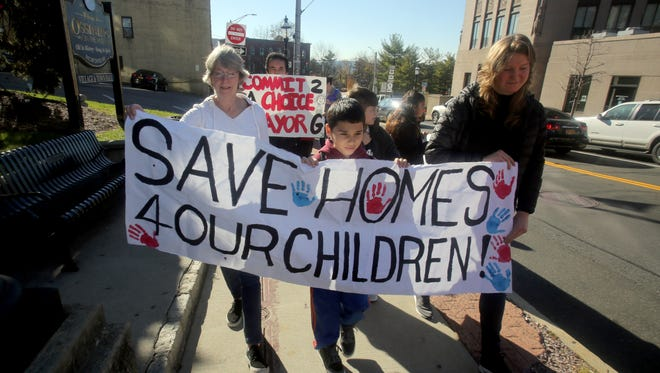 About twenty-five members of Community Voices Heard, a grassroots organization in Ossining, marched through the village Nov. 19, 2016, in support of affordable housing and rent stabilization. The group was calling on Mayor Victoria Hearty to support Ossining tenants who say that without affordable rents, many won't be able to remain in the village.