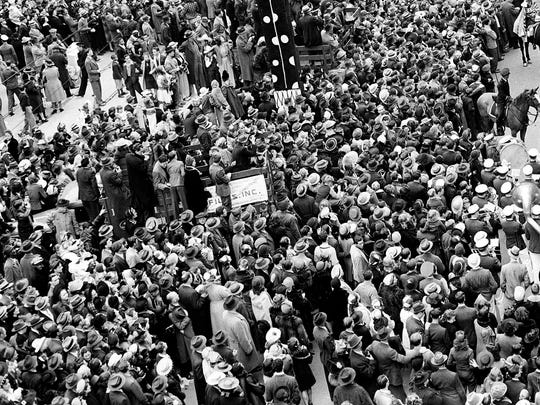 Mardi Gras revelers gather at Canal Street as Rex, King of Carnival, makes his way aboard his float through the crowd in New Orleans, on Feb. 26, 1941. An estimate of half a million people lined the streets for the festivities. The collapse of a 210-year-old building in the heart of the French Quarter is raising warning flags about decay and a lack of rigorous inspections in one of America's oldest and most fragile neighborhoods.
