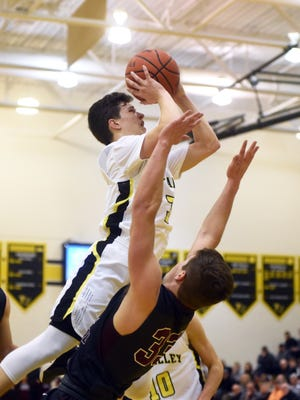 Tri-Valley's Matt King goes up for a shot over Nick Meinert during the second quarter of the Scotties' 64-52 win against visiting John Glenn in Dresden. King was named special mention All-Ohio in Division I on Tuesday by the Ohio Prep Sportswriters Association.