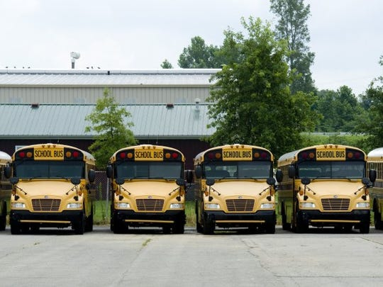 School buses line the parking lot of the Henderson County Schools Transportation Department as the new school year approaches.