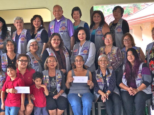 "In keeping with their mission of ""Caring for the Sick and the Elderly,"" the Guam Sunshine Lions Club assists needy individuals with off-island medical treatment expenses. On Aug. 5,  the club donated $200 each to Melanie German (front row, 4th from left) and Emilesia T.Anderson, daughter Joyce Anderson, front row, 7th from left, accepted donation on her behalf.  Pictured, front row from left: L. Ewy Taitano, L. Juie Cruz, Myles Aguon,  German, Micah Aguon, L. Prexy Rosie Matsunaga, Anderson, L. Jovie Mejorada, and L. Julie Garcia.  2nd row l to r: Lions LouJean Borja, Annie Artero, Dot Leon Guerrero, Helen Colby, Lorraine Rivera, Pilar Laguana, Clare Cruz, Jill Pangelinan, and Mary Torres  3rd row l to r:  Lions Margo Espinoza, Connie Rivera, Helen Mendiola, Barbara Flores, Pete Babauta, Marietta Camacho, Violet Camacho, and Dee Cruz."