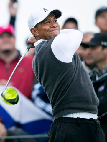 Tiger Woods makes his tee shot to start his second