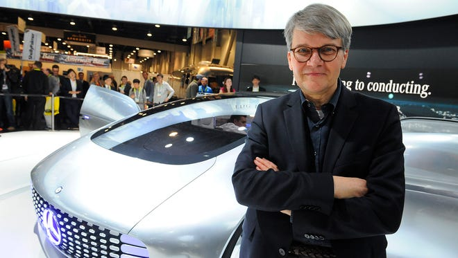 Herbert Kohler with Mercedes-Benz poses with the F015 Luxury in Motion vehicle.    Photo by Tim Loehrke, USA TODAY staff
