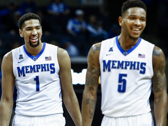 University of Memphis teammates Dedric Lawson (left) and Markel Crawford (right) celebrate during the final minute 62-56 victory over University of South Florida at the FedExForum.