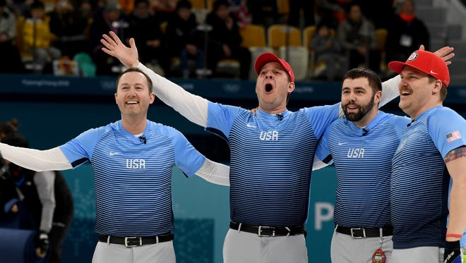 Team USA celebrates after winning the gold medal in curling.