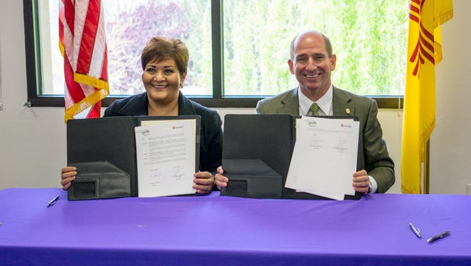 Susan Escarcega Castellanos, President of Universidad Tecnologica de Parral; and Dr. Joseph Shepard, WNMU President show a Memorandum of Agreement signed between the two institutes of higher learning.