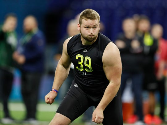 Ball State offensive lineman Danny Pinter runs a drill at the NFL football scouting combine in Indianapolis, Friday, Feb. 28, 2020. (AP Photo/Charlie Neibergall)