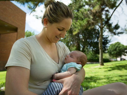 Evin Greensfelder looks at her first born child Margot Greensfelder, 6 weeks, July 21, 2016, outside Young Hall at New Mexico State University campus.