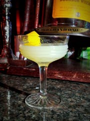 An Absinthe cocktail at Fidel's contains licorice-scented Absinthe, lemon juice, simple syrup and a lemon twist.