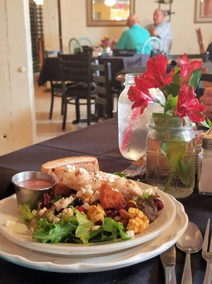 R'z fruity chicken salad is a great light choice for a summer lunch. It is topped with grilled chicken, oranges, berries, dried apples, brown sugar croutons and feta cheese, and is served with the house poppyseed dressing.