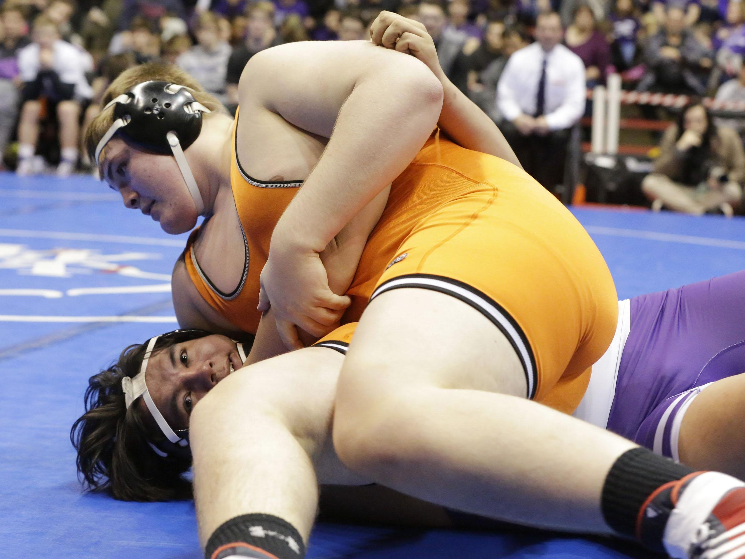 Kaukauna's Keaton Kluever, top, controls Stoughton's Aodan Marshall in the 285-pound match Saturday against Stoughton at the WIAA Division 1 state wrestling team tournament in Madison. Kluever pinned Marshall in 52 seconds.