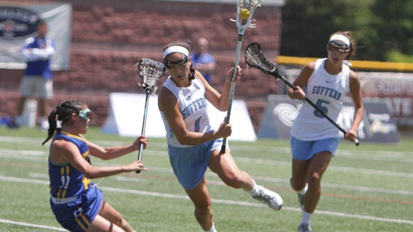 Suffern's Baley Parrott runs past West Islip's Paige Sherlock during the 2015 State Class A Championship at SUNY-Cortland. West Islip edged the Mounties 10-9.