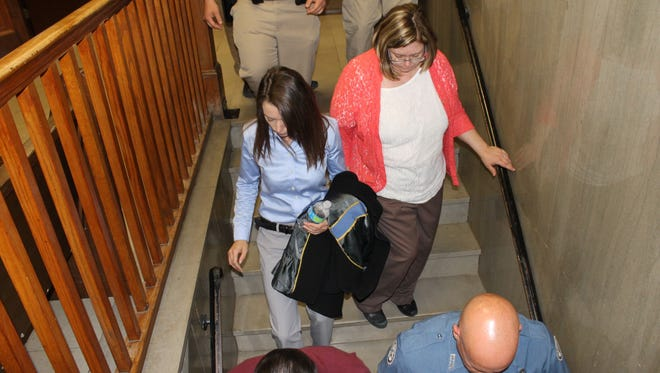 Christina Scroggin, left, leaves the courtroom with her mother, Roxanne Donner, after the second day of her first-degree murder trial on Tuesday at the Marion County Courthouse in Yellville. Scroggin is accused of murdering her live-in boyfriend, Raul Turrieta, on April 2, 2013.