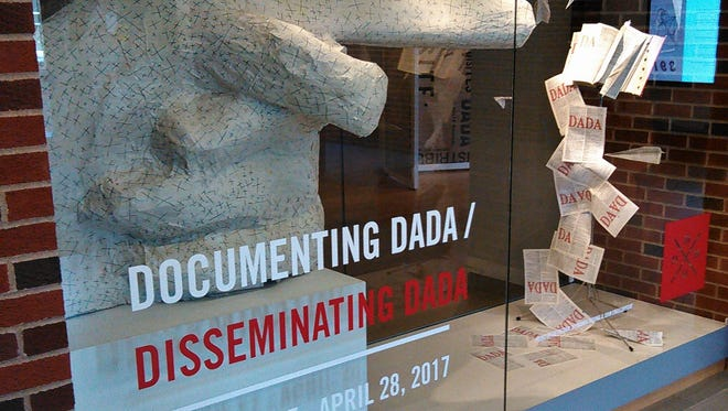 This glass-encased diorama created by Kalmia Strong and John Engelbrecht introduces an exhibit at the University of Iowa Main Library focused on Dada, an important, controversial art movement spawned by World War I.