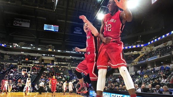 Park Tudor Panthers Jaren Jackson Jr., right, and Kobe Webster celebrate as time expires and Park Tudor captures the Class AA IHSAA boys basketball state title with their 84-57 win over Westview at Bankers Life Fieldhouse in Indianapolis on Saturday, March 29, 2014.