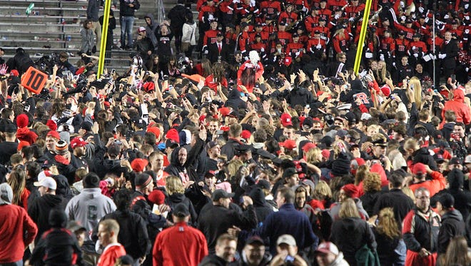 Fans rush onto the field as Rutgers beats Michigan 26-24 for its first ever Big Ten win.   On Saturday October 4,,2014 Photo: Mark R. Sullivan/Staff Photographer