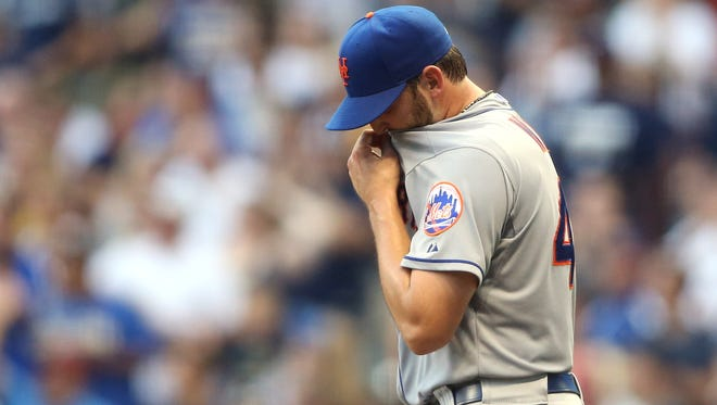 Mets starting pitcher Jonathon Niese reacts after giving up three runs to the Milwaukee Brewers in the fifth inning at Miller Park on Saturday.